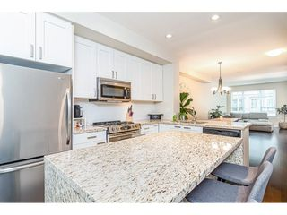 """Photo 13: 216 2501 161A Street in Surrey: Grandview Surrey Townhouse for sale in """"HIGHLAND PARK"""" (South Surrey White Rock)  : MLS®# R2499200"""