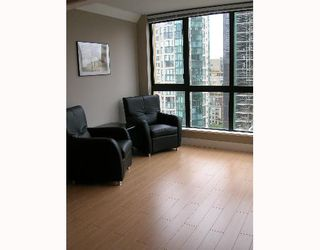 """Photo 2: 1207 488 HELMCKEN Street in Vancouver: Downtown VW Condo for sale in """"ROBINSON TOWER"""" (Vancouver West)  : MLS®# V640232"""