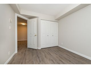 "Photo 11: 404 3170 GLADWIN Road in Abbotsford: Central Abbotsford Condo for sale in ""REGENCY TOWER"" : MLS®# R2427366"