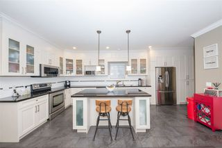 """Photo 1: 7107 196 Street in Surrey: Clayton House for sale in """"Clayton Heights"""" (Cloverdale)  : MLS®# R2437171"""