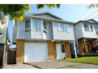 Photo 1: 7360 11TH AV in Burnaby: Edmonds BE House for sale (Burnaby East)  : MLS®# V845540