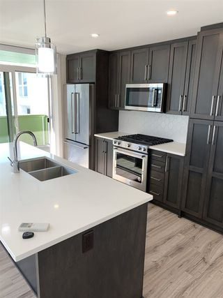"""Photo 5: 205 2565 WARE Street in Abbotsford: Central Abbotsford Condo for sale in """"MILL DISTRICT"""" : MLS®# R2485173"""