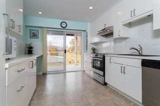 """Photo 1: 248 32691 GARIBALDI Drive in Abbotsford: Abbotsford West Townhouse for sale in """"Carriage Lane Park"""" : MLS®# R2487204"""