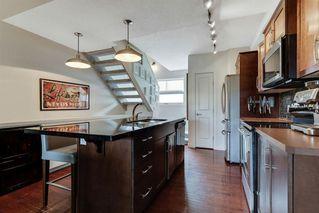 Photo 7: 220 ASPEN HILLS Villas SW in Calgary: Aspen Woods Row/Townhouse for sale : MLS®# A1057579