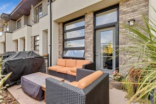 Photo 1: 220 ASPEN HILLS Villas SW in Calgary: Aspen Woods Row/Townhouse for sale : MLS®# A1057579
