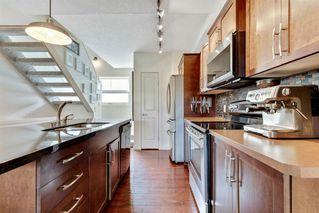 Photo 8: 220 ASPEN HILLS Villas SW in Calgary: Aspen Woods Row/Townhouse for sale : MLS®# A1057579