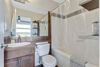 Photo 18: 220 ASPEN HILLS Villas SW in Calgary: Aspen Woods Row/Townhouse for sale : MLS®# A1057579