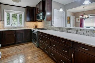Photo 8: 2603 MORLEY Trail NW in Calgary: Banff Trail Detached for sale : MLS®# A1021752