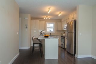 Photo 2: 1003 1225 Kings Heights Way SE: Airdrie Row/Townhouse for sale : MLS®# A1045575
