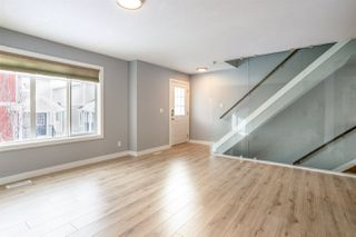 Photo 2: 35 675 ALBANY Way in Edmonton: Zone 27 Townhouse for sale : MLS®# E4221023
