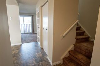 Photo 12: 10670 Beaumaris RD NW in Edmonton: Zone 27 Townhouse for sale : MLS®# E4178193