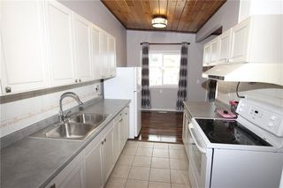 Photo 2: A 1427 43 Street SE in Calgary: Forest Lawn Row/Townhouse for sale : MLS®# C4291024
