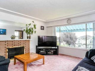 Photo 2: 1329 E 62ND Avenue in Vancouver: South Vancouver House for sale (Vancouver East)  : MLS®# R2494112