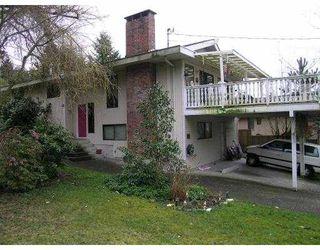 Photo 1: 90 APRIL RD in Port Moody: Barber Street House for sale : MLS®# V579948