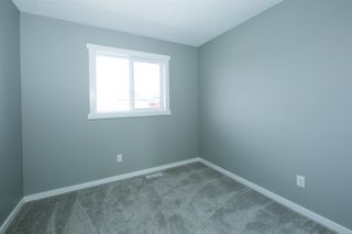 Photo 14: 2268 GLENRIDDING Boulevard in Edmonton: Zone 56 Attached Home for sale : MLS®# E4173358