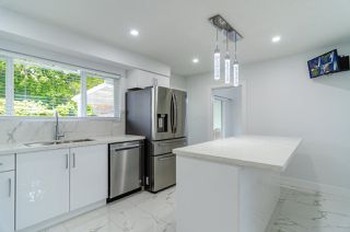 Photo 12: 8225 NELSON Avenue in Burnaby: South Slope House for sale (Burnaby South)  : MLS®# R2511373
