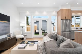 Photo 2: 3093 E 1ST Avenue in Vancouver: Renfrew VE 1/2 Duplex for sale (Vancouver East)  : MLS®# R2518507