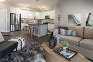 Photo 2: 213 100 Auburn Meadows Manor SE in Calgary: Auburn Bay Apartment for sale : MLS®# A1021390