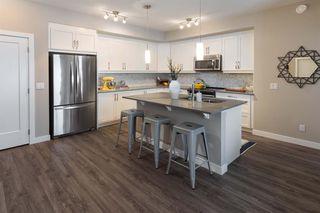 Photo 4: 213 100 Auburn Meadows Manor SE in Calgary: Auburn Bay Apartment for sale : MLS®# A1021390