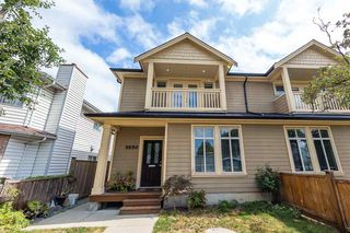 Photo 1: 5650 MAIN Street in Vancouver: Main 1/2 Duplex for sale (Vancouver East)  : MLS®# R2402480