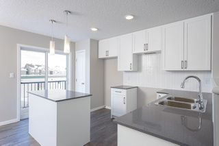 Photo 2: 109 3305 Orchards Link in Edmonton: Zone 53 Townhouse for sale : MLS®# E4175898