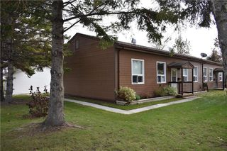 Photo 1: 132 MAPLE Street in Gimli: Aspen Park Condominium for sale (R26)  : MLS®# 1929370