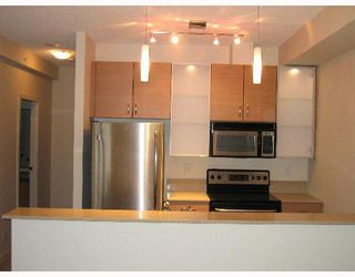 """Photo 2: 318 SMITHE Street in Vancouver: Downtown VW Townhouse for sale in """"YALETOWN PARK II"""" (Vancouver West)  : MLS®# V633230"""