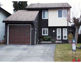 Photo 1: 7377 PARKWOOD Drive in Surrey: West Newton House for sale : MLS®# F2803343