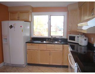 Photo 5: 1055 ABBEYDALE Drive NE in CALGARY: Abbeydale Residential Detached Single Family for sale (Calgary)  : MLS®# C3312404