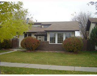 Photo 1: 1055 ABBEYDALE Drive NE in CALGARY: Abbeydale Residential Detached Single Family for sale (Calgary)  : MLS®# C3312404