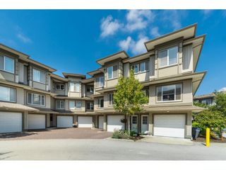 "Photo 1: 179 18701 66 Avenue in Surrey: Cloverdale BC Townhouse for sale in ""ENCORE AT HILLCREST"" (Cloverdale)  : MLS®# R2394716"
