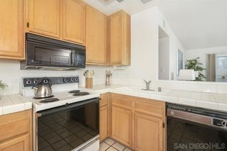 Photo 3: RANCHO SAN DIEGO Condo for sale : 2 bedrooms : 11580 Fury Ln #165 in El Cajon