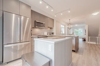 """Photo 2: 6 9718 161A Street in Surrey: Fleetwood Tynehead Townhouse for sale in """"CANOPY"""" : MLS®# R2457524"""
