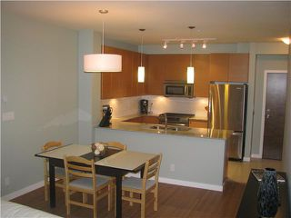"""Photo 2: # 204 101 MORRISSEY RD in Port Moody: Port Moody Centre Condo for sale in """"LIBRA IN SUTER BROOK"""" : MLS®# V868331"""