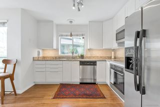 """Photo 2: 103 3400 SE MARINE Drive in Vancouver: Champlain Heights Condo for sale in """"TIFFANY RIDGE"""" (Vancouver East)  : MLS®# R2409100"""