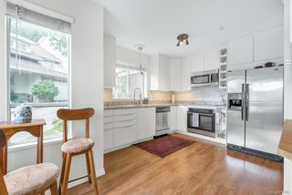 """Photo 3: 103 3400 SE MARINE Drive in Vancouver: Champlain Heights Condo for sale in """"TIFFANY RIDGE"""" (Vancouver East)  : MLS®# R2409100"""
