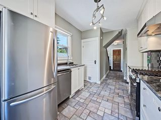 Photo 3: 1440 21 Avenue SW in Calgary: Bankview Detached for sale : MLS®# A1009748