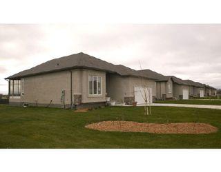 Photo 1: 56 Britton Bay: Condominium for sale (Headingley North West Winnipeg Winnipeg Winnipeg and Area Manitoba)  : MLS®# 2901464