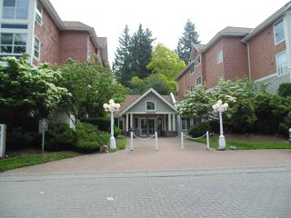 "Photo 1: 409 9668 148 Street in Surrey: Guildford Condo for sale in ""Hartford Woods"" (North Surrey)  : MLS®# R2450892"