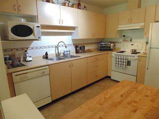 "Photo 4: 409 9668 148 Street in Surrey: Guildford Condo for sale in ""Hartford Woods"" (North Surrey)  : MLS®# R2450892"