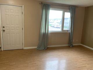 Photo 2: 68 HABITAT Crescent NW in Edmonton: Zone 35 Townhouse for sale : MLS®# E4199941