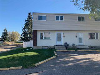 Photo 1: 68 HABITAT Crescent NW in Edmonton: Zone 35 Townhouse for sale : MLS®# E4199941