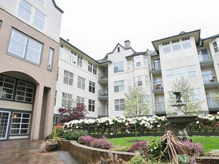 """Photo 1: 209 20200 56TH Avenue in Langley: Langley City Condo for sale in """"THE BENTLEY"""" : MLS®# F2710508"""