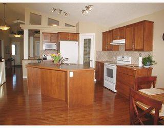 Photo 6: 5 GLENVISTA Key: Cochrane Residential Detached Single Family for sale : MLS®# C3306011