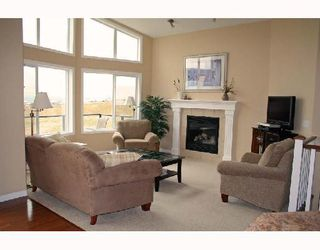 Photo 3: 5 GLENVISTA Key: Cochrane Residential Detached Single Family for sale : MLS®# C3306011