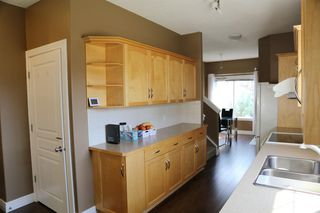 Photo 10: 84 BRIDLERIDGE Manor SW in Calgary: Bridlewood Row/Townhouse for sale : MLS®# A1029938