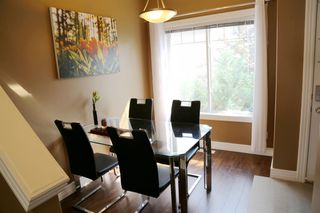 Photo 7: 84 BRIDLERIDGE Manor SW in Calgary: Bridlewood Row/Townhouse for sale : MLS®# A1029938