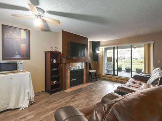 "Photo 2: 111 10157 UNIVERSITY Drive in Surrey: Whalley Condo for sale in ""Sutton Manor"" (North Surrey)  : MLS®# R2420765"