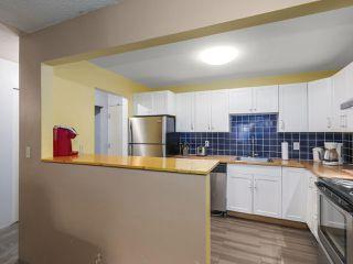 "Photo 10: 111 10157 UNIVERSITY Drive in Surrey: Whalley Condo for sale in ""Sutton Manor"" (North Surrey)  : MLS®# R2420765"
