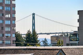 "Photo 1: 412 1425 ESQUIMALT Avenue in West Vancouver: Ambleside Condo for sale in ""Oceanbrook"" : MLS®# R2469530"